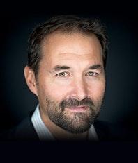 Headshot of Mark Caputo.